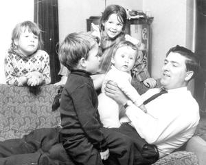 John Hume playing with his children