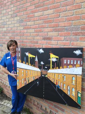 A delighted Kate Laing with her painting