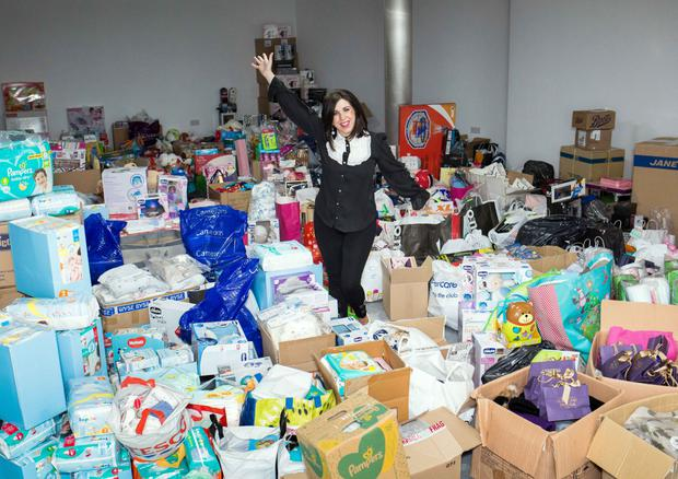 Caroline with all the presents that are being sent out to NI children