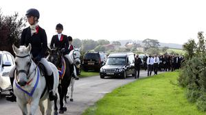 Sad occasion: Riders escort the funeral cortege of Ellie in Portaferry yesterday