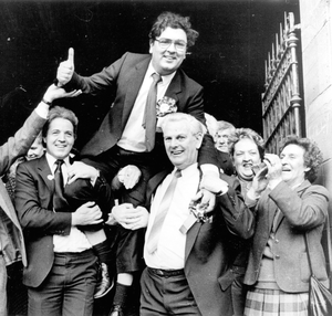 John Hume is carried aloft through Londonderry city centre after being returned as MP for Foyle in 1987