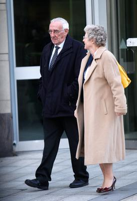 Robert Spratt talks with surgeon Sigi Refsum yesterday as he leaves the inquest into the death of his wife Joyce