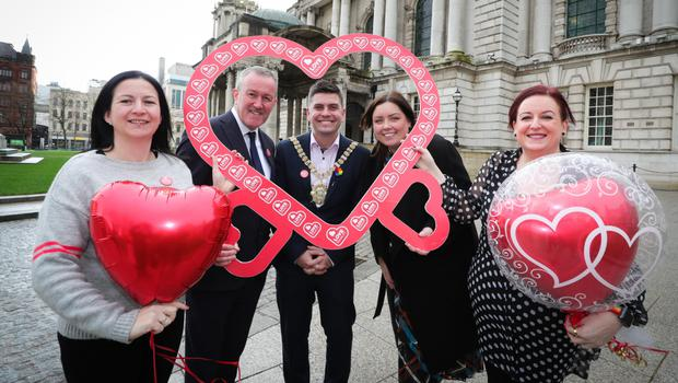 Finance Minister Conor Murphy, Communities Minister Deirdre Hargey and the Lord Mayor of Belfast, Daniel Baker, with Cara McCann (left) from Love Equality NI and Amanda McGurk (right) at Belfast City Hall
