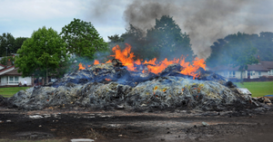 The smouldering remains of the Lisburn bonfire yesterday