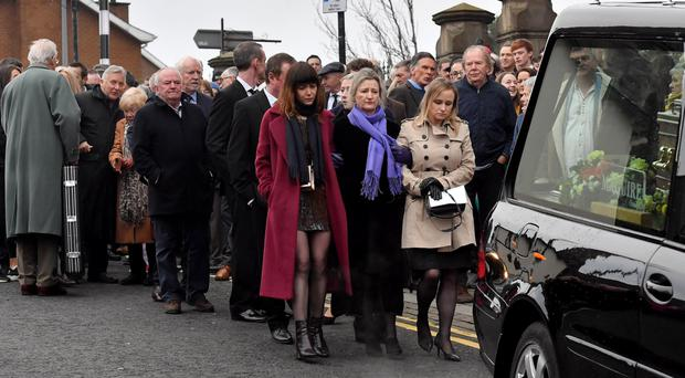 Arty McGlynn's wife Nollaig Casey, family and friends at Sacred Heart Church in Omagh for the funeral of the musician