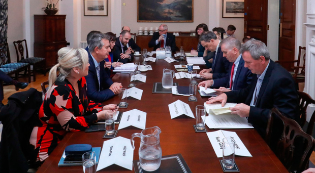 Secretary of State Julian Smith (third from right) hosts a summit at Stormont with politicians including Michelle O'Neill, Edwin Poots, Nichola Mallon and Steve Aiken to try to solve the spiralling health service crisis