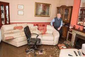 Bobby Donnell in his damaged home