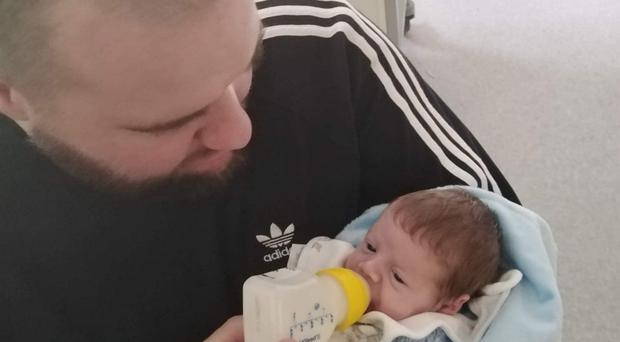 Father Matty Simpson with baby Franklin