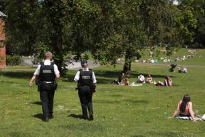 Police and sunbathers in Botanic Gardens in Belfast