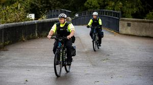 Officers riding the new electric bicycles in Victoria Park in Belfast (Liam McBurney/PA)