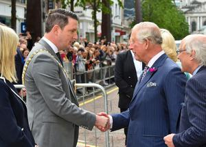 Charles shakes hands with new Lord Mayor of Belfast John Finucane