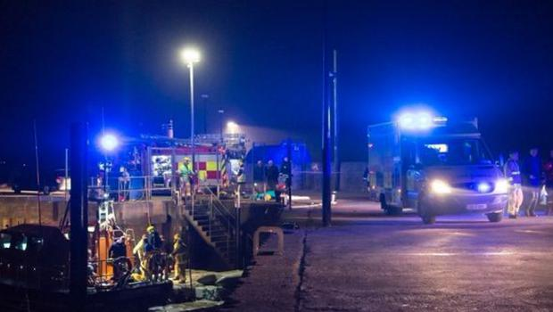 Rescue services at the pier in Buncrana where a family of five perished after their car slide into Loch Swilly