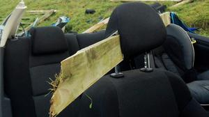 A wooden fence post speared through the head rest of the seat the man was sitting in when the crash happened in the Lisburn area (PA/PSNI)