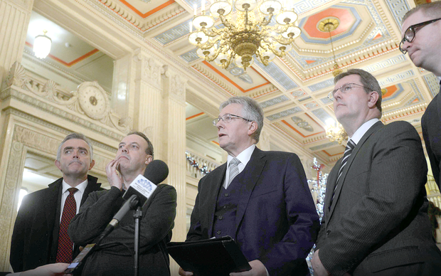 Peter Robinson and his DUP team address the media after the successful talks