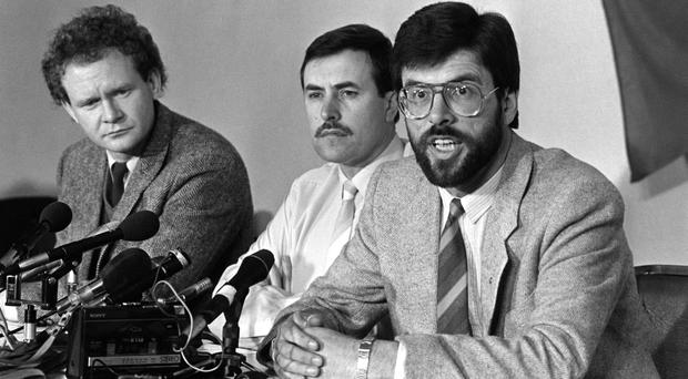 Mitchel McLaughlin flanked by Martin McGuinness (left) and Gerry Adams at a Press conference in Londonderry in 1987