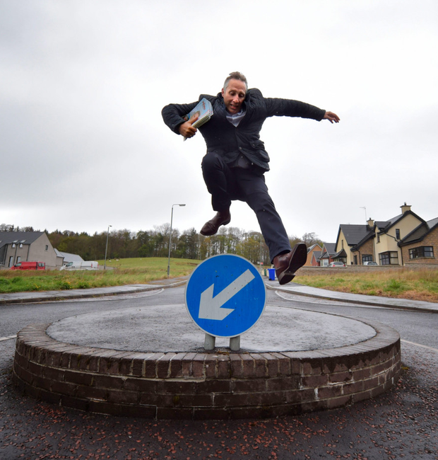 DUP Westminster candidate Ian Paisley jumps over a roundabout sign while canvassing in Ballymoney yesterday
