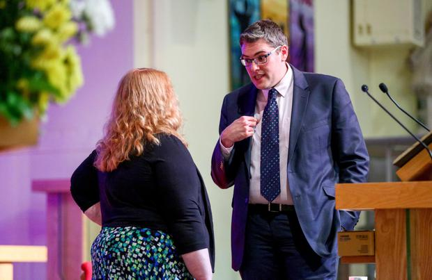 Alliance's Naomi Long and Gavin Robinson of DUP have a discussion after the debate at the Willowfield church in east Belfast last month