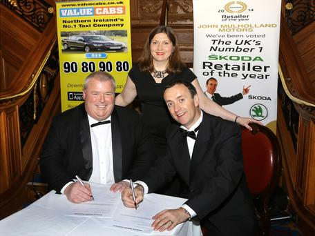 Signing their new deal were Christopher McCausland, managing director of Value Cabs, Yulia Eldridge, Skoda Fleet area manager and John Mulholland, managing director of John Mulholland Motors