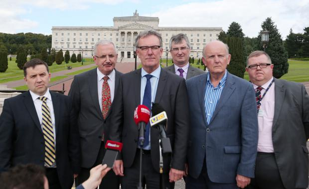 Mike Nesbitt leads a UUP delegation to Stormont House to meet the Secretary of State Theresa Villiers yesterday