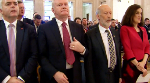 The DUP's Jonathan Bell, Sinn Fein's Martin McGuinness, Alliance leader David Ford and Secretary of State Theresa Villiers during the singing of the National Anthem at Stormont on Wednesday