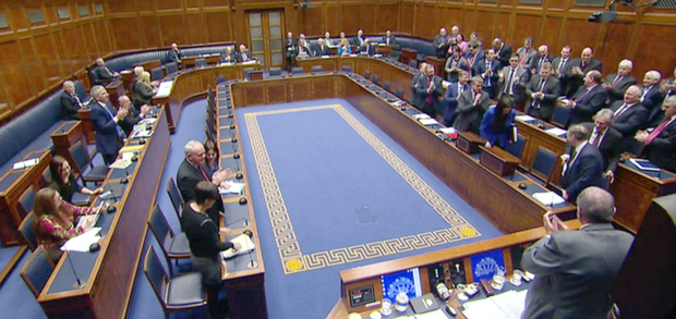 MLAs give a standing ovation to the outgoing First Minister, Peter Robinson