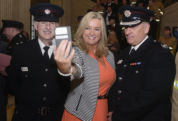 Rod O'Hare and John Denvir of the Northern Ireland Fire Service with Jo-Anne Dobson MLA at Stormont yesterday