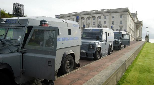 Police at Stormont after a raid on Sinn Fein offices there in 2002