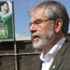 Gerry Adams faces the media at Sinn Fein HQ on Monday