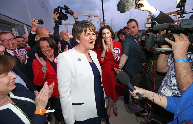 DUP leader and First Minister Arlene Foster celebrates with party colleagues at the Belfast count centre last night