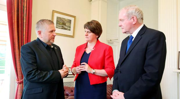 Father Gary Donegan, First Minister Arlene Foster and deputy First Minister Martin McGuinness