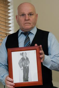 Daniel Bradley with a picture of his brother Seamus, who was shot during Operation Motorman