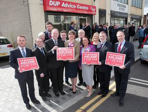 First Minister Arlene Foster joins candidates for East Antrim, South Antrim and North Belfast with other party colleagues outside the DUP offices in Glengormley