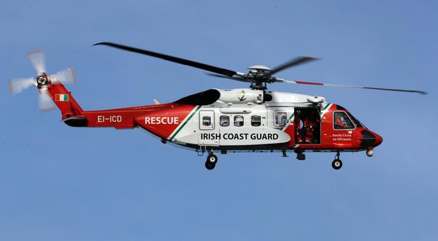 An Irish Coast Guard helicopter is part of the search (PA)