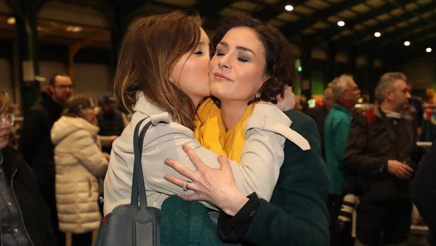 Fine Gael's Kate O'Connell is embraced after she lost her seat in Dublin Bay South (Niall Carson/PA)
