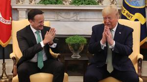 Taoiseach Leo Varadkar (left) and US president Donald Trump greeting each other with a namaste gesture in the Oval Office (Niall Carson/PA)