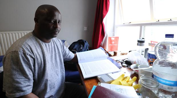 Lesley Mkoko studies in his Direct Provision room (Niall Carson/PA)