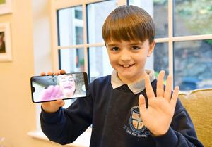 Jack Dunne, 11, chats with grandmother Mary over Zoom as they support Louth County Council's 'Superconnectors' campaign asking younger people to teach older relatives how to set up and use technology. Picture: Ken Finegan/Newspics.