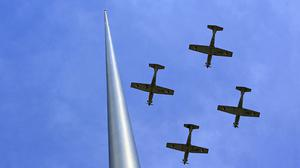 Aircraft from the Irish Defence Forces fly past the Spire on O'Connell Street, Dublin, during the 97th anniversary of the 1916 Easter Rising against British rule in Ireland