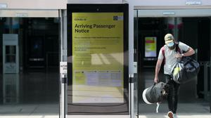 A notice for arriving passengers regarding the Covid-19 Passenger Locator Form at Terminal 2 in Dublin Airport as a requirement for people arriving in Ireland from overseas to alert the authorities where they will be self isolating has come into effect (Brian Lawless/PA)