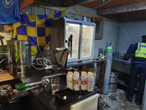 At around 8.30pm on New Year's Eve, Gardai executed a search warrant on the suspected shebeen premises operating close to Kildare Town. (An Garda Siochana/PA)