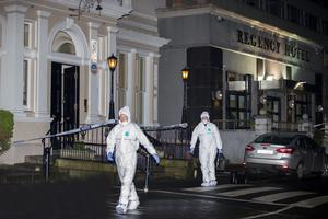 Forensic officers outside the Regency Hotel where hooded gunmen in Garda-style uniform carried out a murderous raid