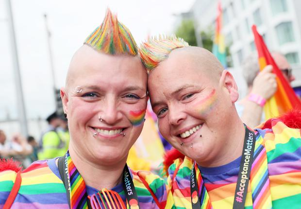 Participants, and the city, were decked out in rainbow colours (Brian Lawless/PA)