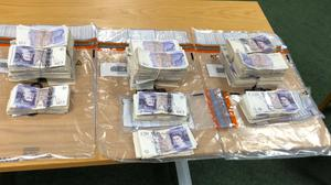 Two men have been arrested after £66,440 (approximately 76,228 euros) was found in a car at Dublin Port (An Garda Siochana/PA)