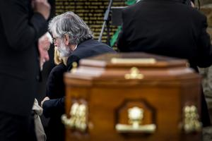 Former Sinn Fein president Gerry Adams offers an embrace of condolence to Teresa Storey at the funeral of her partner Bobby Storey (Liam McBurney/PA)
