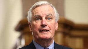 The EU's chief Brexit negotiator Michel Barnier arrives to meet business stakeholders and cross-border groups at the Guildhall in Derry (Niall Carson/PA)