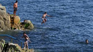 Swimmers at the Forty Foot in Sandycove, Dublin which has been reopened (Brian Lawless/PA)