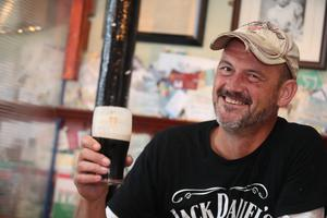 Angus Fleming enjoyed a pint on the day the pubs reopened (Niall Carson/PA)