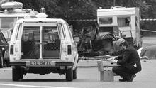 A police photographer at the scene of a car bomb in Rotton Row, Hyde Park, London, in 1982
