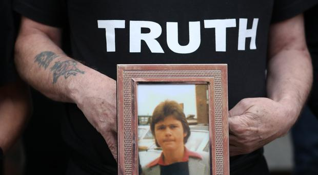 Eugene Kelly, holds a photo of his 17-year-old brother Robert who died in the 1981 Stardust fire, as some of the families of the victims of the fire hold a press conference about the new inquest at Buswells Hotel in Dublin (Niall Carson/PA)