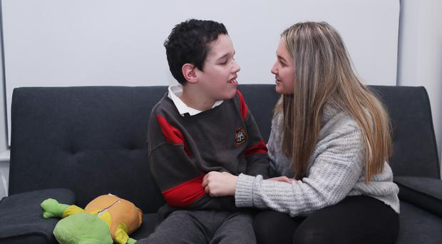 Carer Shauna Tighe with her brother Daniel at their home in Tallaght Dublin (Niall Carson/PA)